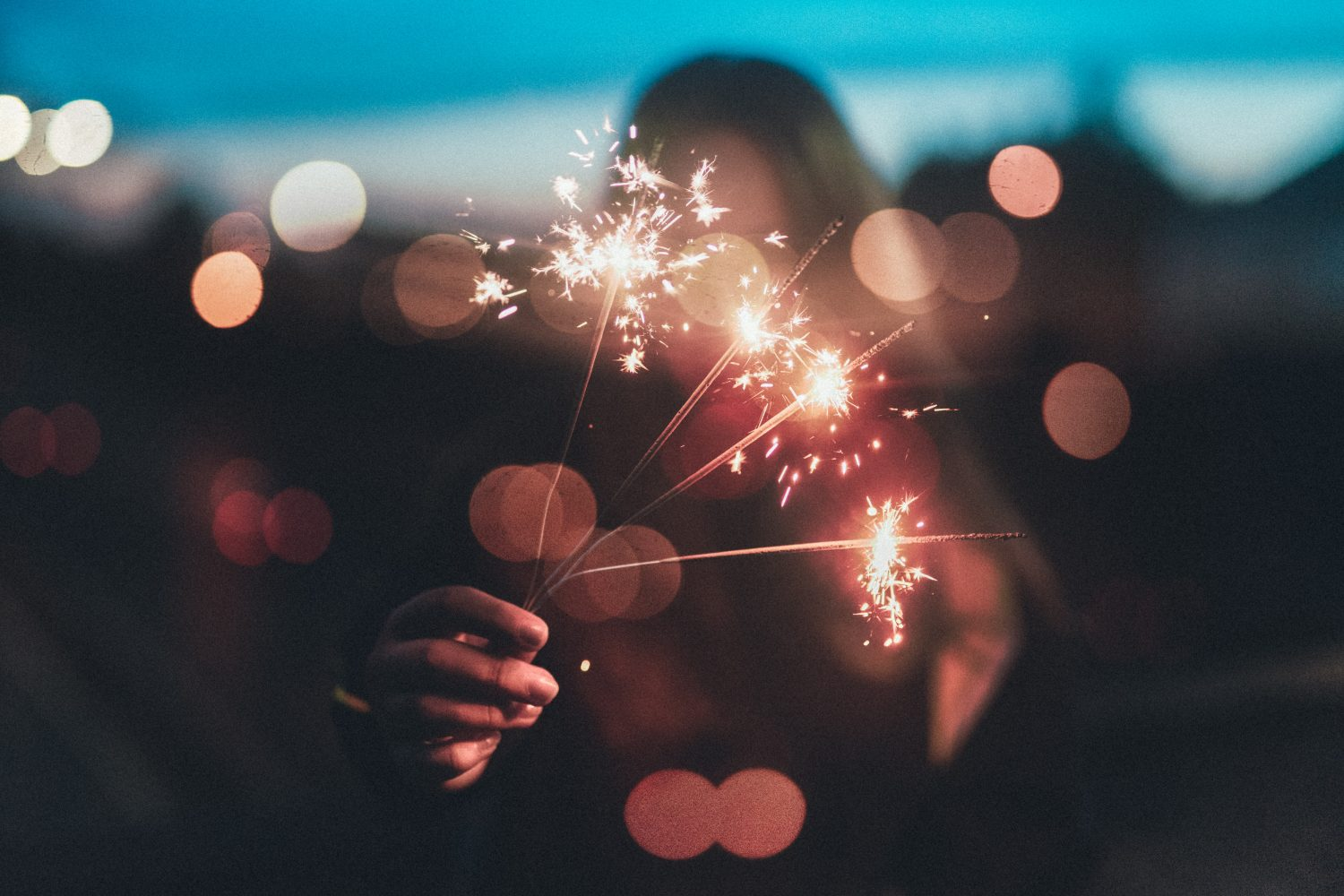 Lady holding a sparkler on new years