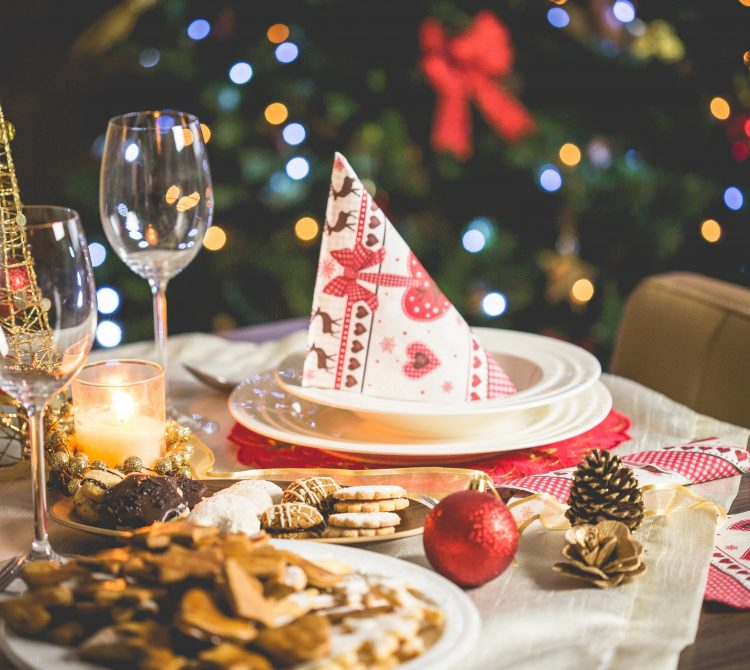 Christmas table setting with wine glass and biscuits