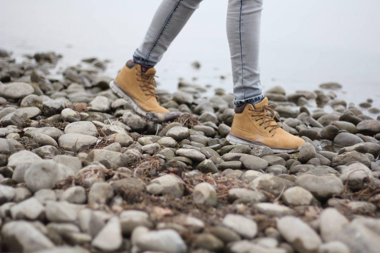 women's legs walking on rocks
