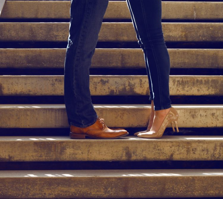 legs of couple hugging on the steps