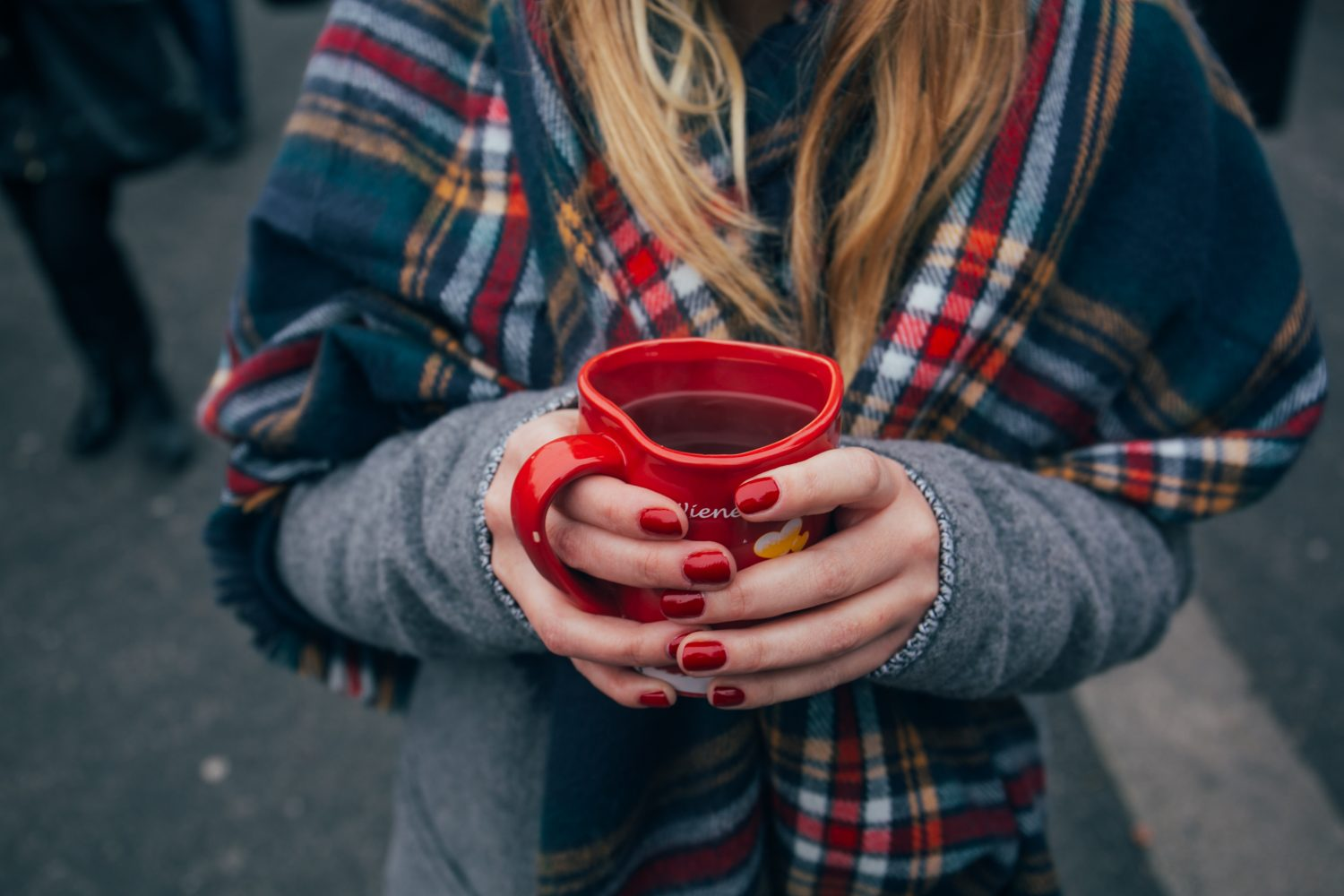 girl with cup of coffee in scarf