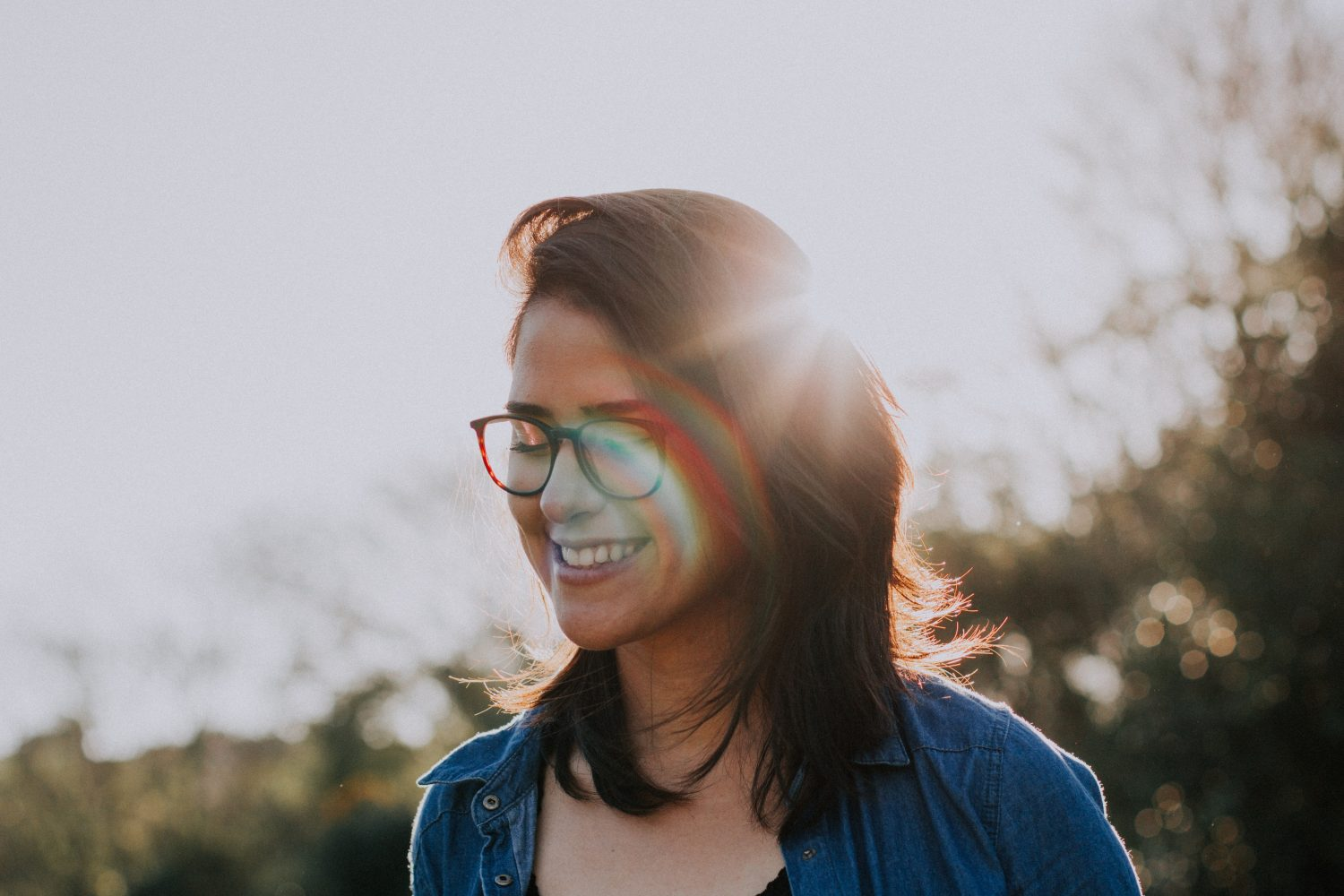 Women wearing glasses smiling in the sun