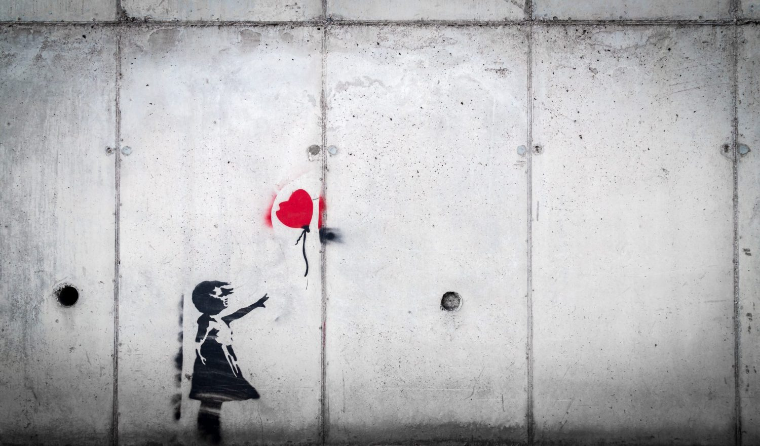 stencil art of girl with red balloon